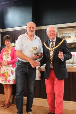 Howard collects his cup for the winning veg.